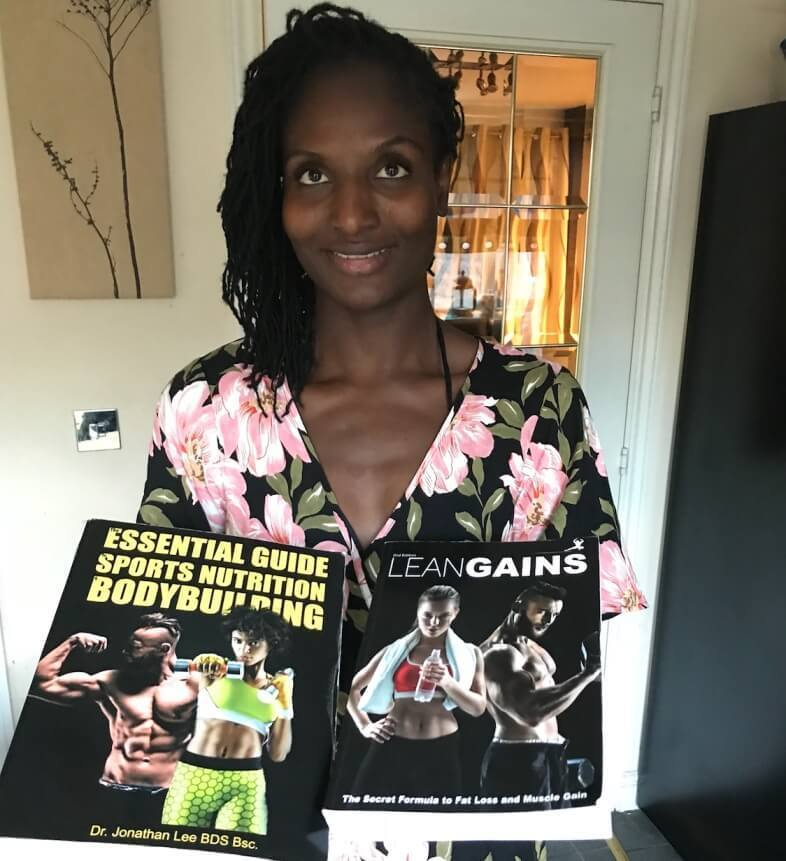 fitness model holding fitness books lean gains