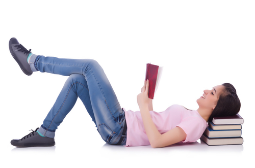 woman lying down reading book
