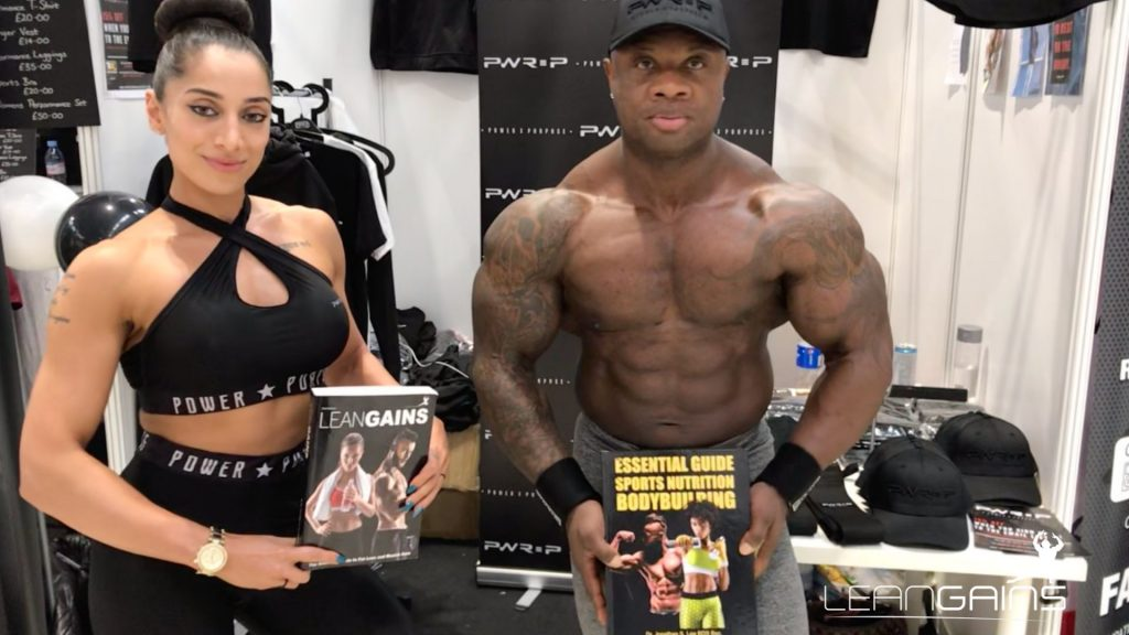 fitness couple holding lean gains books